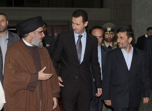 Lebanon's Hezbollah leader Sayyed Hassan Nasrallah (L) chats with Syria's President Bashar al-Assad (C) and Iran's President Mahmoud Ahmadinejad (R) while on their way to an official dinner in Damascus February 25, 2010. REUTERS/Sana