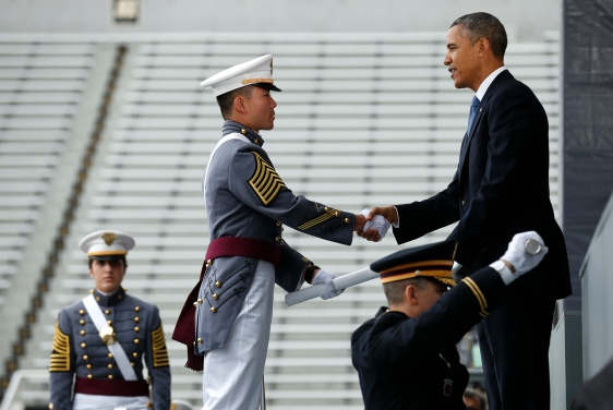 U.S. President Obama hands a diploma to a graduate during commencement ceremony at the United States Military Academy at West Point (REUTERS/Kevin Lamarque)