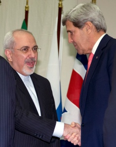 US Secretary of State John Kerry shakes hands with Iranian Foreign Minister Mohammad Javad Zarif at the United Nations Palais in Geneva
