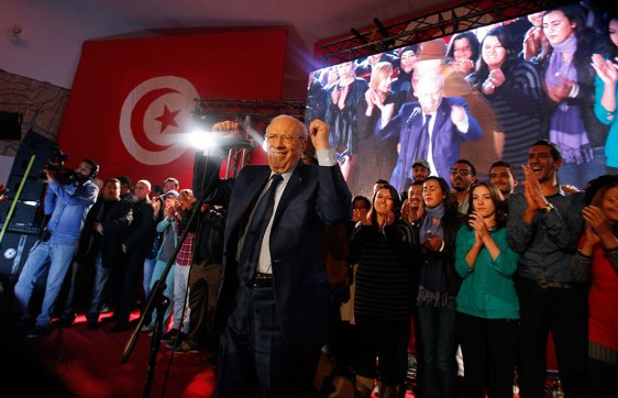 Beji Caid Essebsi (C), presidential candidate and leader of Tunisia's secular Nidaa Tounes party, holds a presidential electoral campaign rally in Tunis December 13, 2014. Tunisia will hold the run-off of its first democratic presidential election on December 21. REUTERS/Zoubeir Souissi